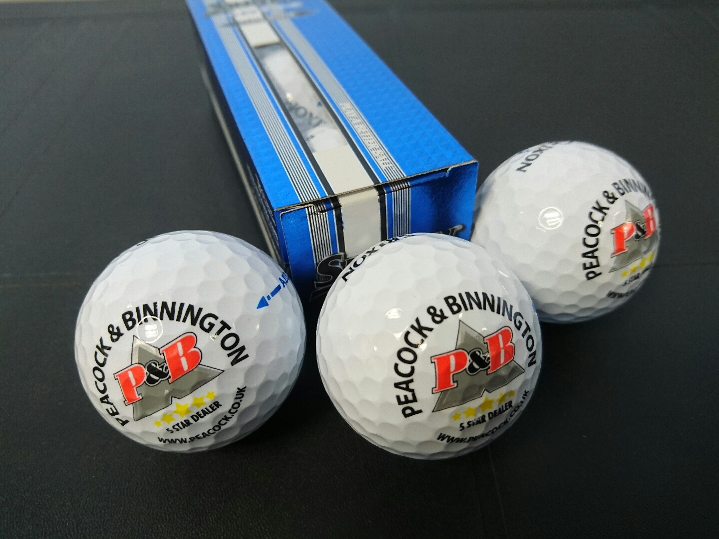 Charity golf day balls sponsored by Peacock and Binnington