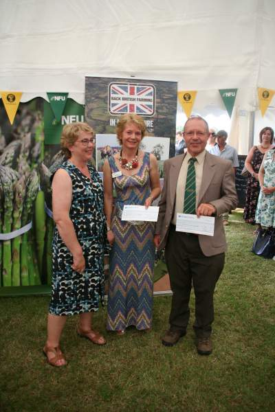 Minty Willoughby presenting cheques to Hugh Wykes of RABI and Sophie Dunn of LRSN following fundraising thorughout her tenure as Lincs County NFU chairman